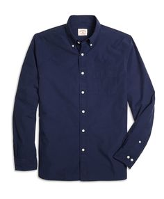 """<a href=""""#pdplearnmore"""" class=""""lm"""">The Red Fleece Collection</a><br>Our sport shirt is made from cotton poplin and cut slimmer in the body for a more fitted look. The button-down collar, a Brooks Brothers innovation, keeps you looking your best and features a button on the center back. Our signature 6-Pleat Shirring® at the barrel cuffs reinforces Brooks Brothers dedication to a well-made sport shirt. Additional features include a left chest pocket. This shirt is machine washable for easy…"""