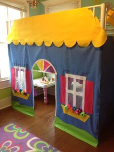 Adorable DIY Playhouse loft bed with tutorial. So cute for a child's room!
