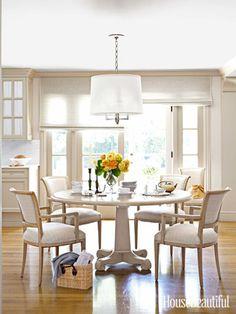 In the breakfast area of this Corona del Mar, California, house, Conrad window shades filter the light.