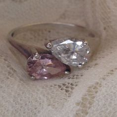 Sterling CZ ring Stunning light pink and clear pear shape Cubic Zirconia sterling silver ring. The stones are a really nice size and they just sparkle. The markings are hard to read but one side definitely is STER for sterling the other marking I believe says CZ DO size 9 sterling Jewelry Rings