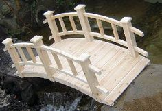 I want a small bridge similar to this in my yard. I want it stained to match my decks. and I want knock out roses on the sides as you go over it.