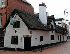 The Horse & Jockey is the only surviving thatched property left in Wrexham. Little history known prior to the 20th century. Investigations of its structure suggest that originally it was a 16th century timber framed hall house & extended in the 17th century and subdivided. A few surviving pieces of timber framing. The Horse and Jockey was named after Fred Archer, a local champion jockey in the late 19th century - Hope Street, Wrexham
