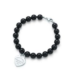 Return to Tiffany® small heart tag in silver on a black onyx bead bracelet. | Tiffany & Co.