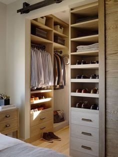 Masculine Closet Design With Interior Sliding Barn Door Opening To Built In Shoe Shelves Drawers Clothes Storage And Woven Baskets
