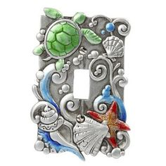 Light switch plate is decorated with sea shell, turtle and a starfish and surrounded with ocean waves.