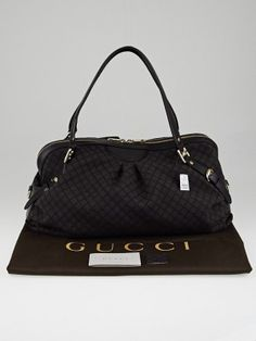 This chic and sophisticated Gucci Brown/Black Diamante Canvas Large Bridle Boston Bag is one you won't want to miss out on. With its sleek design and spacious interior, this Bridle Boston bag can comfortably hold all your daily essentials. The logo hardware and pleated details are truly a statement of timeless elegance. Tote it on your arm or over the shoulder, this versatile bag is great for everyday use. Retail price is $1590.
