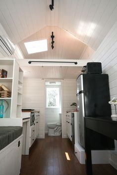 The Inaugural by East Coast Homes, a 160 sq ft tiny house on wheels. Currently for sale in Raleigh, NC.