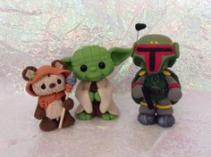 A ewok yoda and bobba fett made by my mom out of polymer clay my mom is @kindclay