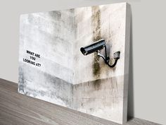 Banksy, what are you looking at? Canvas Prints Australia. It is available as a stretched canvas, rolled canvas, or printed on fine art paper.