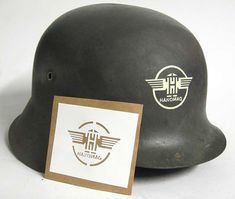 Hanomag Helmet Stencil During WW2, the car plant made military vehicle engines, a military version of their heavy tractor renamed the SS-100, and half track troop carriers. Hanomag 20 B, a 4-wheel-drive Small Unit-Personnel Carrier was produced 1937-1940 (ca. 2000) under the parentage of Stower (as the R180, R200 and Type 40). Capacity problems by Stoewer resulted in co-production by both BMW (as the 325) and Hanomag.  www.warhats.com