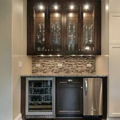 small wet bar with mini fridge, sink, overhead glass cabinets and backsplash""