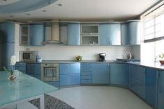 Modern Kitchen in Slivery Blue with Built-in Appliances - Homeclick Community