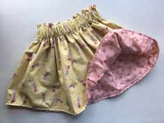 This reversible skirt is darling and perfect for the little girl who loves to run and play! One one side of this reversible skirt is vintage rose Woven Fabric, Cotton Fabric, Reversible Skirt, Sewing Elastic, Elastic Waist Skirt, Skirts For Sale, Fabric Design, Boho Shorts, Little Girls