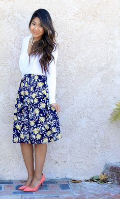 Urban Outfitters floral skirt, Nasty Gal wrap blouse and Coral pumps.