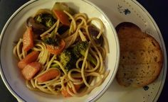 Tonight's dinner: vegetable stir fry over pasta w/Texts toast.