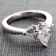 Elegant Trillion Engagement Ring with a 0.90 Carat F VVS2 Pear Center Diamond
