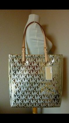 Michael Kors MK Monogram Mirror Metallic Jet Set NS North South Tote Pale Gold MICHAEL Michael Kors http://www.amazon.com/gp/product/B00C0GJVJ8/ref=as_li_qf_sp_asin_il_tl?ie=UTF8&camp=1789&creative=9325&creativeASIN=B00C0GJVJ8&linkCode=as2&tag=wwwjackiesbou-20