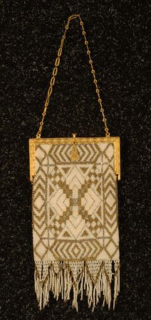 FRENCH ART DECO BEADED BAG. Gilt steel frame and link chain with engraved pattern, rectangular bag with geometric micro-bead design in white silver and bronze, sawtooth bead fringe whitakerauction.com