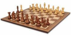 """FIERCE KNIGHT STAUNTON CHESS SET IN GOLDEN ROSEWOOD & BOXWOOD WITH WALNUT CHESS BOARD - 3.5"""" KING  The pieces are triple weighted for exceptional stability on the chess board. The bottom of the pieces are padded with the traditional thick green baize for easily sliding from square to square and a soft feel when placing. The chess board has 2.25"""" squares, the perfect size for this chess set."""