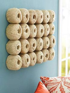 DIY wall art with balls of twine. More budget DIY decorating: http://www.midwestliving.com/homes/decorating-ideas/diy-decorating/