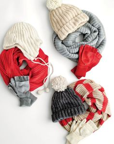 J.Crew women's ribbed trapper hat, ribbed pom-pom beanie, solid infinity scarf, striped infinity scarf and ribbed glittens.