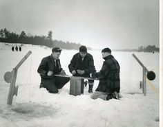 Three men play cards while ice fishing, Wisconsin Rapids, Wisconsin, ca. 1950. From South Wood County Historical Corporation.