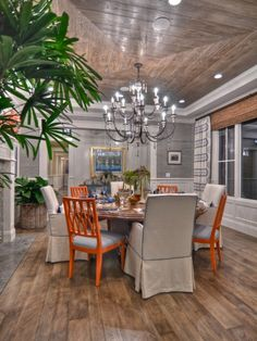 Dining Room - Informal but with style.  Love the mix of woods on the floor and the amazing ceiling with pops of color.in the alternating chairs.  The chandelier brings a touch of glam......casual but so elegant.