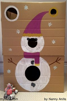 Snowman toss game made from a massive cardboard box. A great game for Christmas that the whole family can get involved in.