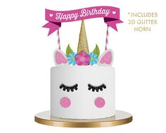 Decorate a cake in just minutes with this fun cake decorating kit. • Includes all pieces on cake. • Optional personalization of text on banner. • Pieces come assembled. • Includes 3D glitter unicorn horn. • Glitter accents. • Premium semi-gloss 100lb paper. • Banner topper is approx. 10H x 10W from top and approx. 4.5W from the bottom. • The cake in sample is an 8 cake. • Physical item will look identical to sample. • Digital/laser print quality. • Electronically cut. • Single-sided piec...