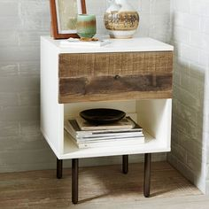 "Reclaimed Wood + Lacquer Nightstand | west elm $349 Best of both worlds. Town meets country on our Reclaimed Wood + Lacquer Nightstand, framing rustic pine in a sleek lacquer frame. The wood comes from solid pine shipping pallets, reinvented into unique storage pieces for the home. 18""w x 17""d x 25""h. Reclaimed pine wood drawer. Engineered wood case with glossy white lacquer finish. Brass plated drawer pull and metal legs in Antiqued Bronze finish. Made in Vietnam. Online/catalog only."