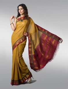 This handloom cotton sari by Srinivas Kamble is typical of Gadwal's attached border work. Two weavers sit on either side of the loom to join in the silk border separately. Similarly the silk pallu is woven into the sari disjointedly – traces of the joints that reflect intricate handloom work are easily noticeable. Also the part which forms the plates of the sari doesn't have any zari, so it allows absolute comfort when put on and is a perfect choice for summers.
