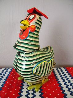 Here's a vintage chicken toy I've never seen during my flea market hunts! Best ever. Tin Litho Mechanical Chicken.