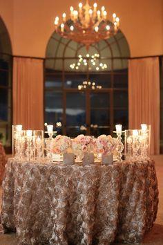 sweetheart table with silk rose tablecloth @myweddingdotcom