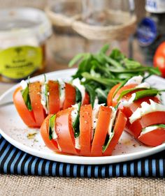 Tomatoes filled with mozzarella cheese and basil. Spiced up with salt and pepper