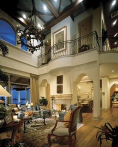 2 story living room with balcony + see-through fireplace between living & dining...