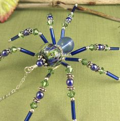 Wire Spider Sculpture Blue Sterling Silver by OzmayDesigns on Etsy Wire Spider, Spider Art, Spider Crafts, Seed Bead Jewelry, Wire Jewelry, Jewelry Crafts, Beaded Jewelry, Jewellery, Beaded Crafts