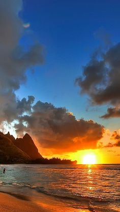 decline_sea_coast_beach_mountains_sun_evening_clouds