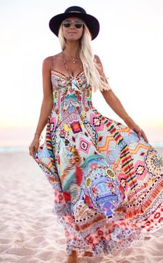 Dancing in the beauty of the golden sunlit sky. A printed maxi dress is a must-have item in the closet of every gypsy girl.