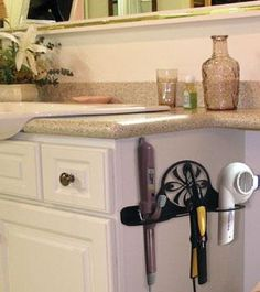wall-mounted hair care caddy with dryer and curling iron