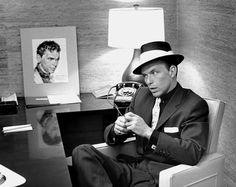 Frank Sinatra in his office. Photo by Murray Garrett