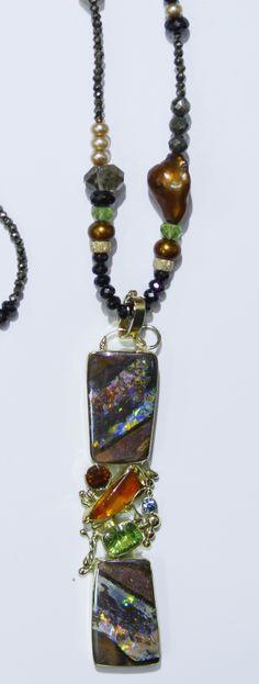 Boulder opal necklace (opalized wood Yowah) with Mexican opal, hessonite garnet, peridot in 22k & 18k gold.  Opals from Bill Kasso