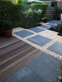 Wood/paving slab combo. Looks very neat & tidy with minimal maintenance. Mixing materials in the garden