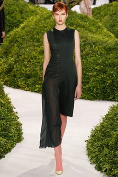 """A curious shape: like two dresses in one. It reminds me of Hepwright's """"oddest dress in the world"""": Frank Usher ruched strapless coctail dress with an assymetric wrappy flappy to the back."""