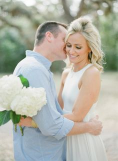 Pretty white peonies and a white dress for this engagement shoot in FL. Photo: KT Merry