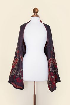 On trend grey (the new neutral) showcases brick red roses and paisley foliage.  Fume'e is the perfect piece to jump start your jacket and cardigan collections! And, it's made of faux wool that styles like a dream but without the itch factor.