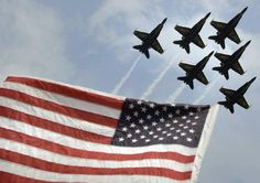 Love this picture ! The U.S. Navy Blue Angels flying high over the American flag Does not get much better than that !