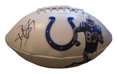 Reggie Wayne signed Indianapolis Colts logo full size football w/ proof photo.  Proof photo of Reggie signing will be included with your purchase along with a COA issued from Southwestconnection-Memorabilia, guaranteeing the item to pass authentication services from PSA/DNA or JSA. Free USPS shipping. www.AutographedwithProof.com is your one stop for autographed collectibles from Miami Hurricanes & NCAA teams. Check back with us often, as we are always obtaining new items.