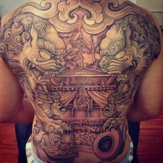 symmetry in back tattoo ... pair of asian lions with cub