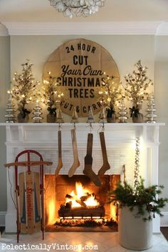 Christmas mantel with vintage stocking stretchers! eclecticallyvintage.com