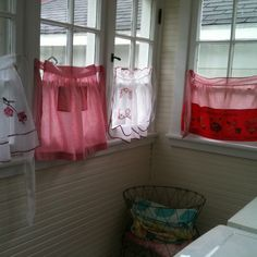 Vintage aprons now laundry room window coverings!